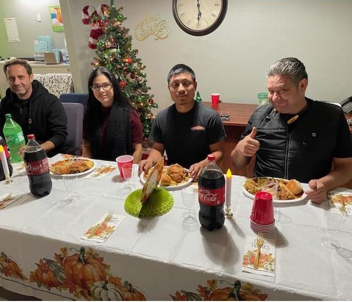 Our SERVPRO team enjoying their Thanksgiving dinner around our fully decorated table.
